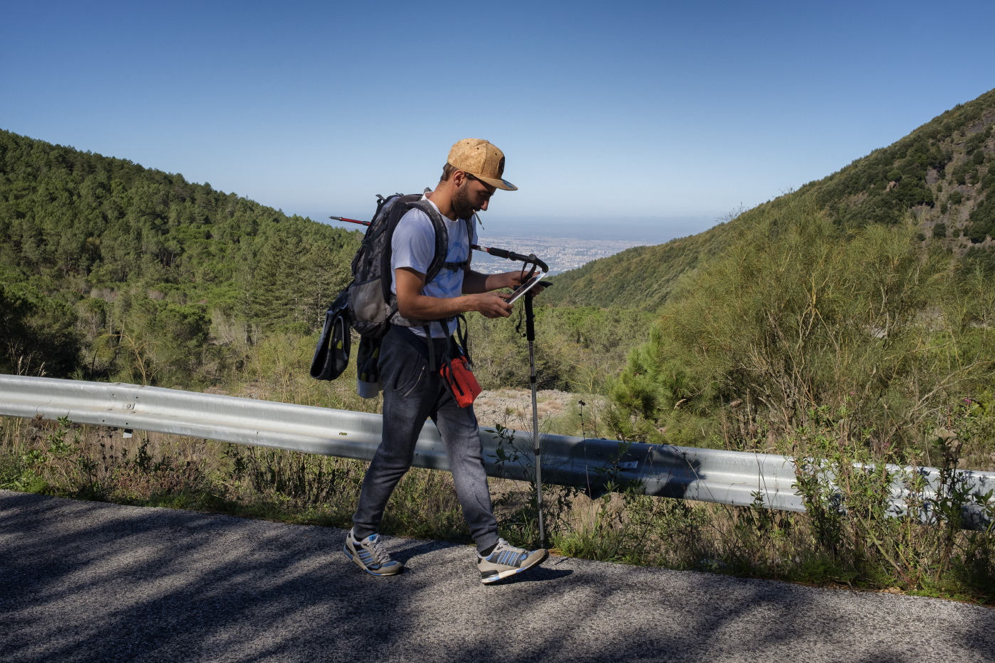 28-year-old Christian Ferri is seen during an anti-prohibitionist climbing, on the road to the Vesuvius mountain. To dull his pain, resulting from dozens of operations he has undergone since a car accident, Christian uses cannabis from self-cultivation or from the black market. Naples, Italy 2016. © Matteo Bastianelli
