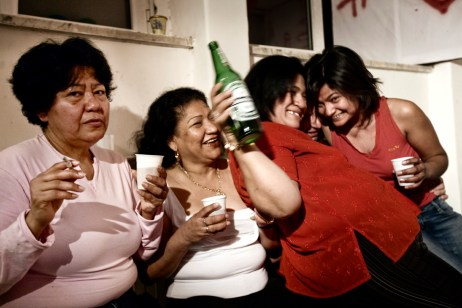 "A birthday party with South Americans and other residents from the squat at ""Casale de Merode"". Many people coming from different ethnic backgrounds and nationalities live together in the squat in harmony. Rome, Italy 2009. © Matteo Bastianelli"