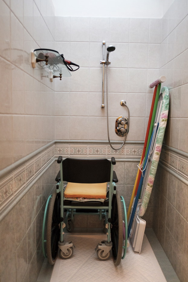 "A bathroom wheelchair in the house of 36-year-old Alberico Nobile, who was left quadriplegic after a car accident in 1995; he is now a member of the ""LapianTiamo"" association. Talsano (Taranto), Italy 2016. © Matteo Bastianelli"