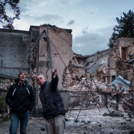 Two men are seen monitoring the damages to their homes after the powerful seismic tremors, measuring up to 5.9 magnitude on the Richter scale, that hit central Italy. Visso, Italy 2016. © Matteo Bastianelli
