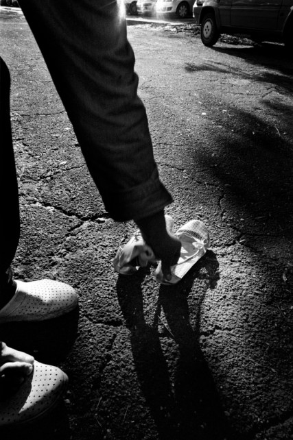 Patrizia is about to wear her flats. Velletri, Italy 2009. © Matteo Bastianelli