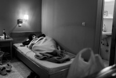 17-year-old Palestinian refugee Mahmood Amora, born and raised in a refugee camp in Damascus, Syria, is seen resting at the Astro Hotel. Polykastro, Kilkis, Greece 2015. © Matteo Bastianelli