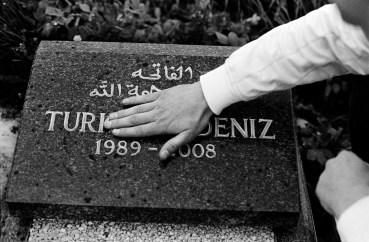 Nihad by Deniz's graveside, one of his friends killed in 2008 by gunfire. Sarajevo, Bosnia and Herzegovina, 2011. © Matteo Bastianelli