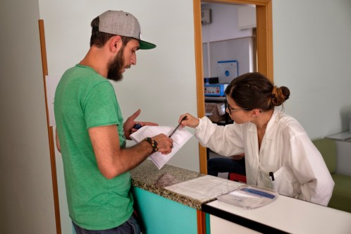 34-year-old Alessandro Raudino, affected by multiple sclerosis, picks up his blood test results at the doctor's surgery. Ever since Alessandro started using cannabis for therapeutic purposes, he has been free from spasms, muscle pain, urine loss, sleep problems and plate inflammation. Modica (Ragusa), Italy 2016. © Matteo Bastianelli