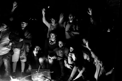 A group of Syrian refugees thrust their hands up after one of them asked the others who wanted to go to Germany. They were kept at the border between Greece and the Republic of North Macedonia for 5 days. Idomeni, Greece 2015. © Matteo Bastianelli