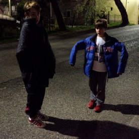 14-year-old Valerio Allegrini on the street with his 8-year-old cousin Giulio Pontani. While their family is gathered in the house, Valerio and Giulio refuse to go inside for fear of other earthquakes. Norcia, Italy 2016. © Matteo Bastianelli