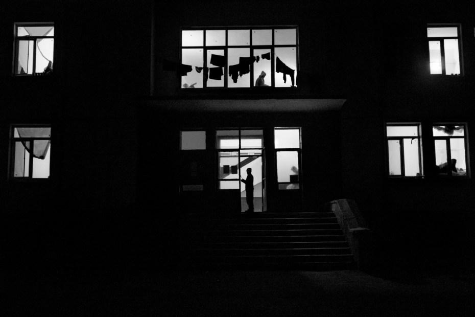 Refugees inside a building at Harmanli refugee camp. Harmanli, Bulgaria 2014. © Matteo Bastianelli