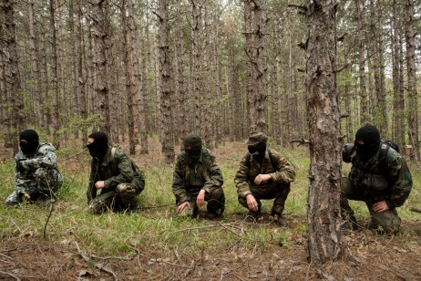 "Some volunteers from the ""Vasil Levski"" Bulgarian Military Veterans Union and from the ""BNO Shipka"" are seen during a drill in the forest near the Nestinarka camp-site. Four to five times a month, they train like an army to face what they consider an invasion to ""Islamize"" Europe. Tsarevo, Bulgaria 2017. © Matteo Bastianelli"