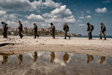 "Some volunteers from the ""Vasil Levski"" Bulgarian Military Veterans Union and from the ""BNO Shipka"" are seen training on a beach in the vicinity of the Nestinarka camp-site on the Black Sea coast. They don't want to be called migrant-hunters: they consider themselves the defenders of the European southern border. Tsarevo, Bulgaria 2017. © Matteo Bastianelli"