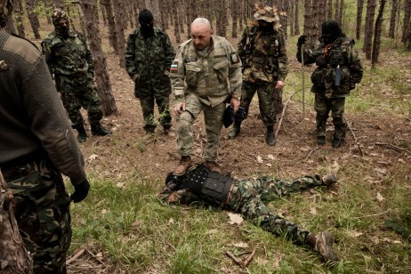 "60-year-old Vladimir Rusev, a retired military officer and Chief Commander of the ""Vasil Levski"" Bulgarian Military Veterans Union, shows the volunteers how to pin a man to the ground. They don't want to be called migrant-hunters: they consider themselves the defenders of the European southern border. Tsarevo, Nestinarka camping, Bulgaria 2017. © Matteo Bastianelli"