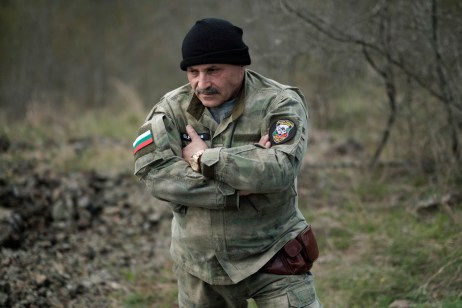 "60-year-old Vladimir Rusev, a retired military officer and Chief Commander of the ""Vasil Levski"" Bulgarian Military Veterans Union, is seen in a forest at the Bulgarian-Turkish border. Yasna Polyana, Bulgaria 2017. © Matteo Bastianelli"
