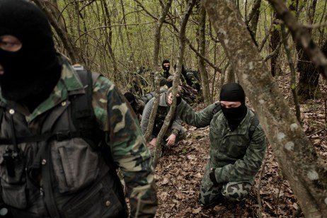 "Some volunteers from the ""Vasil Levski"" Bulgarian Military Veterans Union and from the ""BNO Shipka"" are seen patrolling a forest, about 30 kilometers from the border with Turkey. They wear ski masks to protect their identity; ISIS has put out a reward for some of them. Yasna Polyana, Bulgaria 2017. © Matteo Bastianelli"