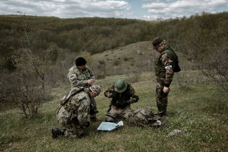 "60-year-old Vladimir Rusev, a retired military officer and Chief Commander of the ""Vasil Levski"" Bulgarian Military Veterans Union, looks at a map with other volunteers to determine the place where they will patrol the Bulgarian-Turkish border. Yasna Polyana, Bulgaria 2017. © Matteo Bastianelli"