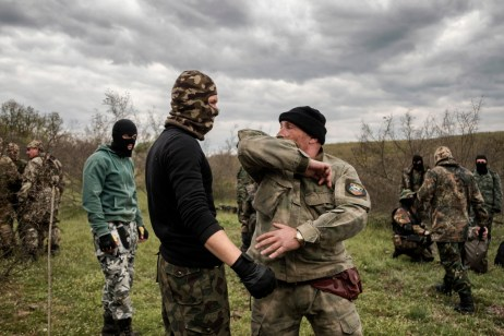 "60-year-old Vladimir Rusev, a retired military officer and Chief Commander of the ""Vasil Levski"" Bulgarian Military Veterans Union, shows the volunteers how to fight in hand-to-hand combat. They don't want to be called migrant-hunters, but they train following military techniques in order to face a possible invasion. Yasna Polyana, Bulgaria 2017. © Matteo Bastianelli"
