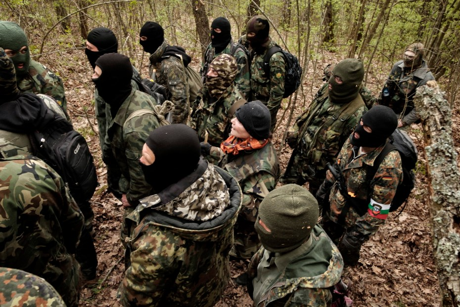 "Some volunteers from the ""Vasil Levski"" Bulgarian Military Veterans Union and from the ""BNO Shipka"" are seen patrolling a forest, about 30 kilometers from the border with Turkey. In the center there is a woman who decided to join the group. Yasna Polyana, Bulgaria 2017. © Matteo Bastianelli"