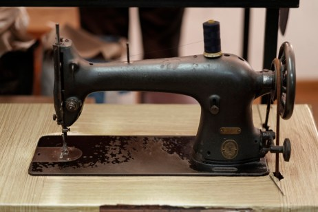 An antique sewing machine in the workshop of Sartoria Ciro Zizolfi. Pupil of masters Ciro Palermo and Claudio Attolini, Ciro Zizolfi perpetuates the traditional craft, solely by hand, of his sartorial creations. Naples, Italy 2017. © Matteo Bastianelli