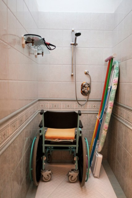 """A bathroom wheelchair in the house of 36-year-old Alberico Nobile, who was left quadriplegic after a car accident in 1995; he is now a member of the """"LapianTiamo"""" association. Talsano (Taranto), Italy 2016. © Matteo Bastianelli"""
