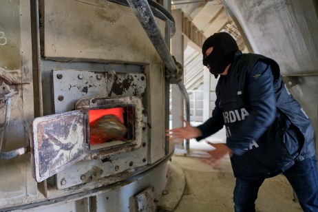 A member of the Counter-narcotics Group (G.O.A.) in the tax unit of the Lecce financial police is seen carrying out the incineration of a load of marijuana seized in a counter-narcotics operation. Galatina (Lecce), Italy 2016. © Matteo Bastianelli