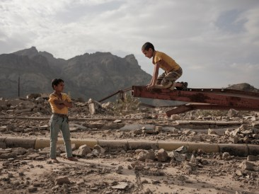 Two boys play among the ruins of a school destroyed by a Saudi-led coalition air strike in Ad Dhale. Since the war began, 2,500 schools have been bombed, closed, used for military purposes, or turned into shelters. Ad Dhale, Yemen 2018. © Matteo Bastianelli