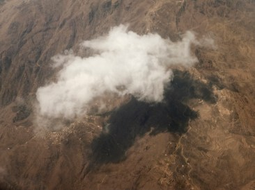 A cloud hovers over mountainous northern Yemen. North and south Yemen were unified in 1990, but the historical distinction still sparks conflict. Today the UN has declared Yemen the world's worst humanitarian disaster. © Matteo Bastianelli
