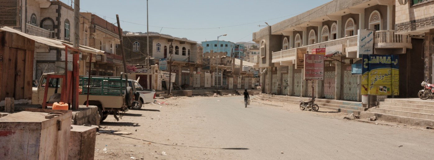 A man is seen walking along a street in the city center during Friday pray. Ad Dhale, Yemen 2018. © Matteo Bastianelli
