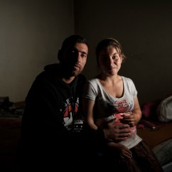 28-year-old Besnik Aliu and his 20-year-old wife Erjona Aliu are portrayed sitting next to each other in their home. Erjona was only 15 years old when they got married and she is now pregnant with their third child. According to UNICEF, of the 16 million adolescent girls who give birth every year, about 90 per cent are already married. Tirana, Albania 2019. © Matteo Bastianelli
