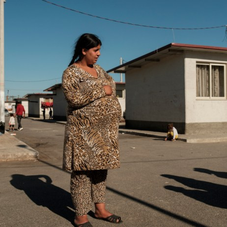 18-year-old pregnant Esmeralda Nuredini is seen inside a Roma community settlement in Tirana. Esmeralda got married at the age of 14. Every year, 12 million girls and young women throughout the world marry before the age of 18. According to UNICEF, ifefforts are not accelerated, more than 150 million girls will marry before their eighteenth birthday by 2030. Tirana, Albania 2019. © Matteo Bastianelli