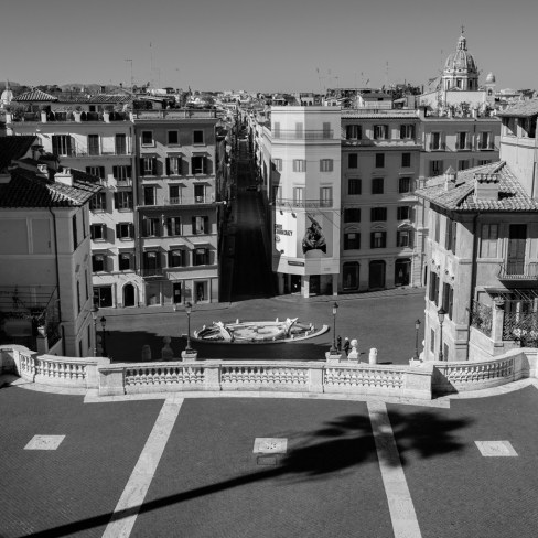 """A view of the empty Piazza di Spagna from the Spanish Steps of Trinità dei Monti. The streets in the city centre are deserted, after the Prime Ministerial Decree """"I stay home"""" disposed that people shouldstay home during Italy's lockdown aimed at stopping the spread of coronavirus, except forwork needs, situations of necessity and health reasons. Rome, Italy 2020. © Matteo Bastianelli"""