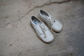 "A pair of shoes belonging to the son of 54-year-old Maria Emma Mora Liberato. Jose Alberto Telles Mora disappeared on 20 September 2011 at the age of 14 years old. After 8 years, Emma was not yet able to find her son and she is now the president of the NGO ""Familias de Acapulco en busca de sus desaparecidos"", a civil organization that helps other families to find their beloved ones. Acapulco, Mexico 2019. © Matteo Bastianelli"