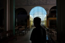 Priest Jesus Mendoza is seen inside the church of a rural congregation outside the city, where he was transferred for his own protection, after serving for years at a church in the violent port city of Acapulco. According to the Catholic Multimedia Center (CCM), 27 priests had been killed in Mexico since 2012, making the country the most dangerous place in Latin America for priests. Acapulco, Mexico 2019. © Matteo Bastianelli