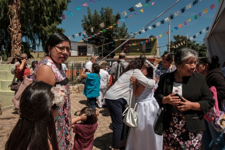 Some families are seen gathered in front of the San Jacinto Amilpas church, celebrating the First Communion of their children. San Jacinto Amilpas, Mexico 2019. © Matteo Bastianelli