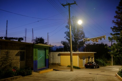 A view at dawn of Los Pinos district, with a torn sign hanging from a power line, through which citizens warn criminals that those who will be found loitering around their properties, will be lynched and exhibited in the street. Huajuapan de León, Mexico 2019. © Matteo Bastianelli