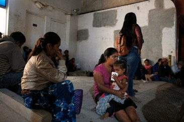 Before sunrise, a young women with her child on her lap is seen along with other indigenous people from the state of Guerrero, waiting in front of the local bank in order to receive a financial support from the government. Tlapa de Comonfort, Mexico 2019. © Matteo Bastianelli