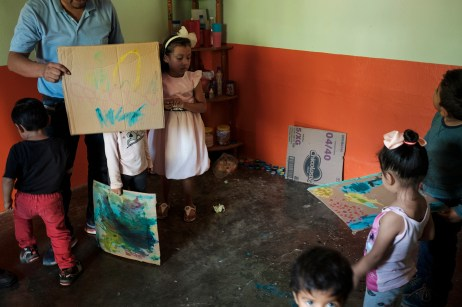 "A group of children are seen playing with 36-year-old Rolando Moreno García, high school teacher and psychologist, in a center for child development. The facility, run by the NGO ""Semillita de Esperanza"" (Little Seeds of Hope), is a place where kids can play and do art and craft activities, giving them the possibility to develop their imagination and creativity. Alcozauca de Guerrero, Mexico 2019. © Matteo Bastianelli"