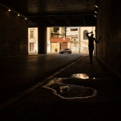A migrant walking through a tunnel that links via Giolitti and via Marsala, where many homeless have found shelter, in the vicinity of the Roma Termini railway station. Rome, Italy, April 2020. © Matteo Bastianelli/National Geographic Society Covid-19 Emergency Fund
