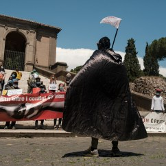 Refugees and volunteers of the Baobab Experience association, are seen protesting during a sit-in in Piazza del Campidoglio after the eviction of a settlement of over 150 migrants carried out at the Roma Tiburtina railway station. Rome, Italy, June 2020. © Matteo Bastianelli/National Geographic Society Covid-19 Emergency Fund