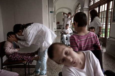 """Patients playing with volunteers. Since 2002 the association """"Garden of Blue Roses"""", has guaranteed a permanent and continuative presence of volunteers at the Gornja Bistra Children's Hospital. Gornja Bistra, Croatia 2009. © Matteo Bastianelli"""