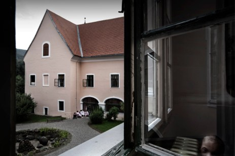On the bottom right-hand side is 8 year old Tony, affected by Wolf- Hirschhorn syndrome. In the background is the left wall of the ex-Castle, transformed into a sanatorium for children after the Second World War and, since 1963, has been a hospital for long-term patients suffering with genetic complaints. Gornja Bistra, Croatia 2009. © Matteo Bastianelli