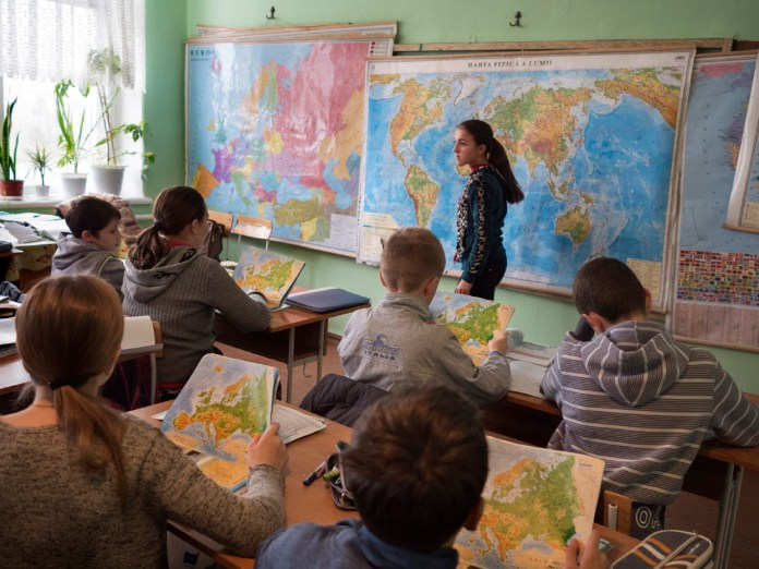 Some students during a geography lesson on Europe. Everyday 200 young Moldovans from Grigoriopol cross the border to study in their own language. In Transnistria they are allowed to study only the Russian language. Doroţcaia, Moldova 2014. © Matteo Bastianelli