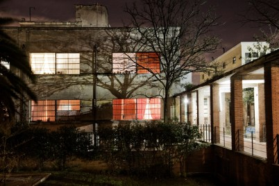 """Night-time view of a clinic that was never opened by the Roman Usl (Health Dept.) For the past 6 years the building has been occupied by approximately 90 families and re-named """"Casale de Merode"""", from the same name as the road where it stands. Rome, Italy 2009. © Matteo Bastianelli"""