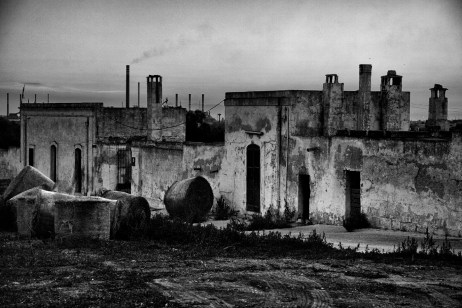 A view of the Fornaro brothers' farmhouse, in the background the chimneystack of the ILVA plant, the largest and most polluted steelwork hub in Europe. Taranto, Italy 2013. © Matteo Bastianelli