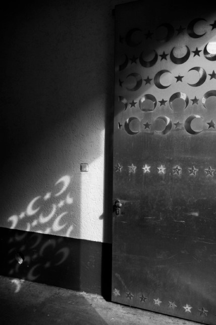 The entrance door of a mosque where Mohamad and Hani went for Friday's pray. Soest, Germany 2017. © Matteo Bastianelli