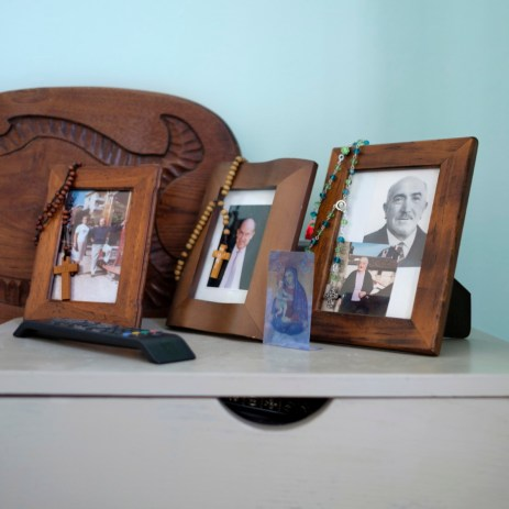 Pictures of some family members of Annamaria and her husband Sabatino, that were found under the rubble of their home and now placed on the nightstand of the hotel room where they are staying. Grottammare, Italy 2017. © Matteo Bastianelli