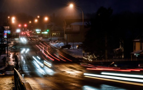 A light drizzle comes down as traffic goes north and south along Sanborn street on Monday night in Mitchell. The light drizzle caused some places to be covered in ice on Tuesday morning. (Matt Gade/Republic)