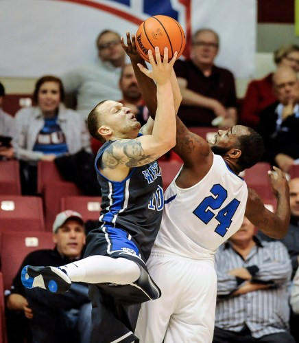 Dakota Wesleyan's Terrell Newton (10) shoots over York College's Marcus Price (24) during the second round of the NAIA Division II men's national tournament on Friday night in the Keeter Gymnasium at the College of the Ozarks in Point Lookout, MO. (Matt Gade/Republic)