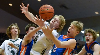 Parkston's Dillan Thuringer (44) and Parkston's Brady Albrecht (2) scramble for a loose ball with Clark/Willow Lake's Noah Huber (45) during a game on Saturday at the Corn Palace in Mitchell. (Matt Gade/Republic)