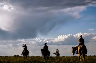 Competitors warm-up their horses out in a field just north of arena before competing in the Wessington Springs Foothills Rodeo at the Jerauld County 4-H Grounds.