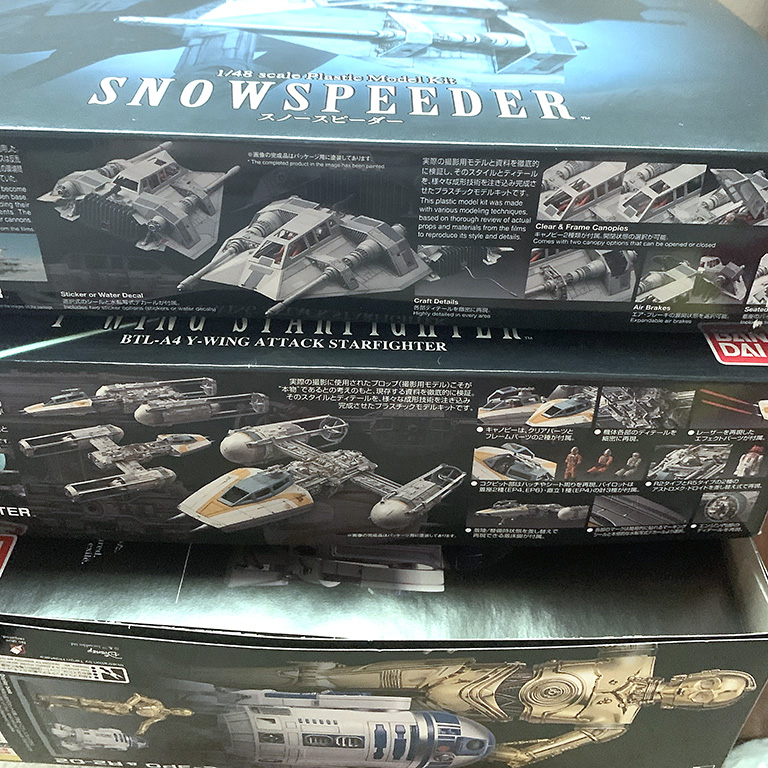 Small stack of new Bandai Star Wars models in the queue.