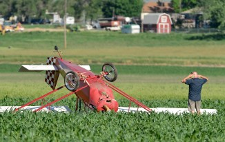 A man is seen standing near a plane that crashed in a field near 75th Street behind Vance Brand Municipal Airport on Tuesday. Matthew Jonas / Staff Photographer June 23, 2015