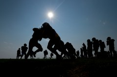 Frederick High School's football team practices on Thursday. Matthew Jonas / Staff Photographer Aug. 20, 2015